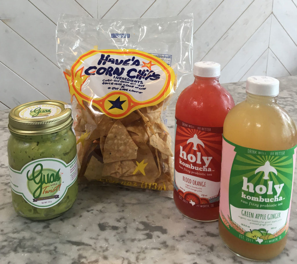 Guac with a Twist, Have'A Corn Chips, Holy Kombucha fizzy probiotic tea in Blood Orange and Green Apple Ginger. All locally made and available at Royal Blue Grocery.