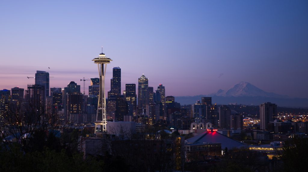 The Space Needle Observation tower lights up the night in the Seattle skyline.