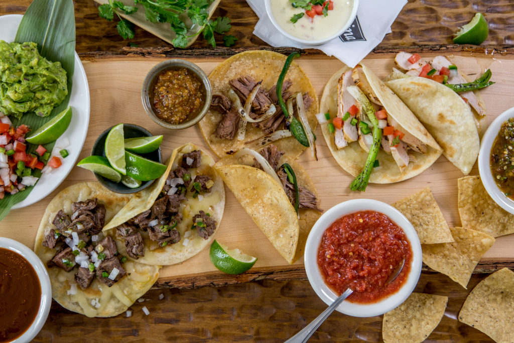 Try a sampling of street style, shredded brisket or chicken fajita tacos from Mi Cocina's Dinner Taqueria menu.