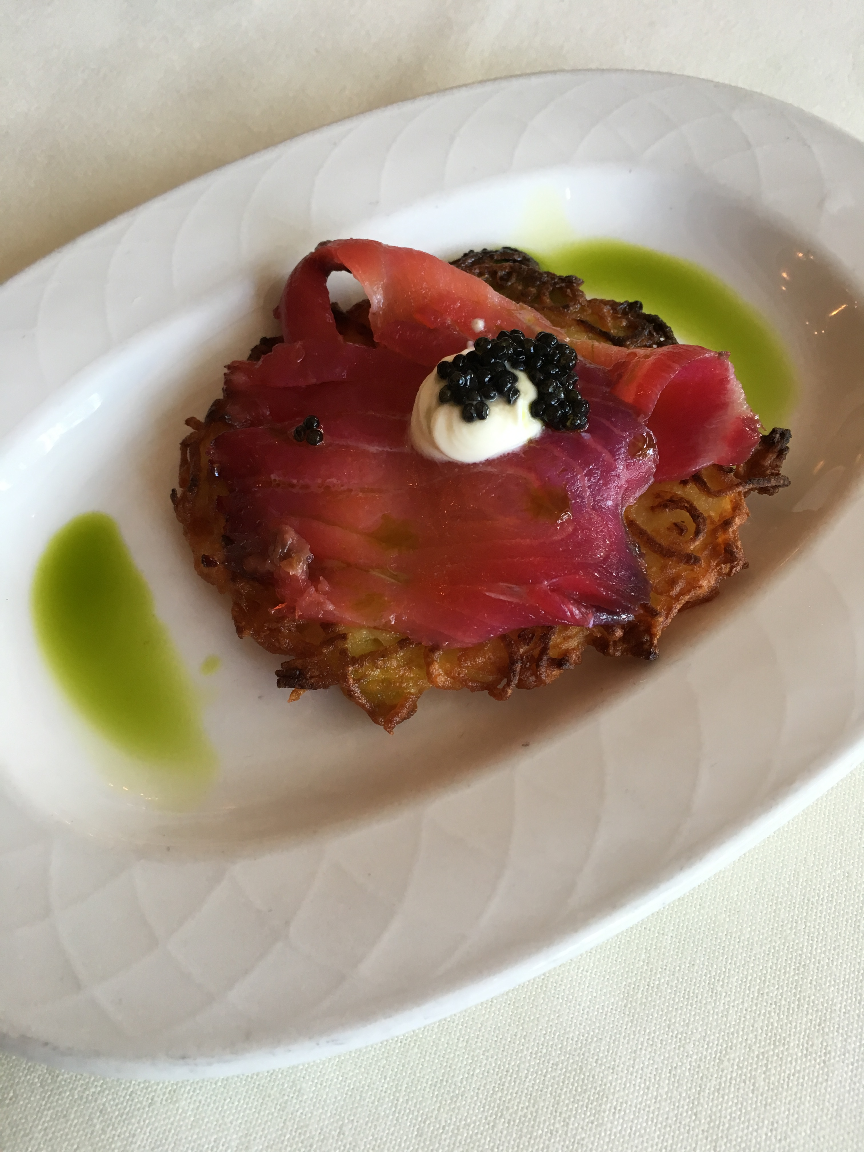 Red Beet Cured Pacific Salmon with Potato Latkes, Sour Cream and Paddlefish Caviar