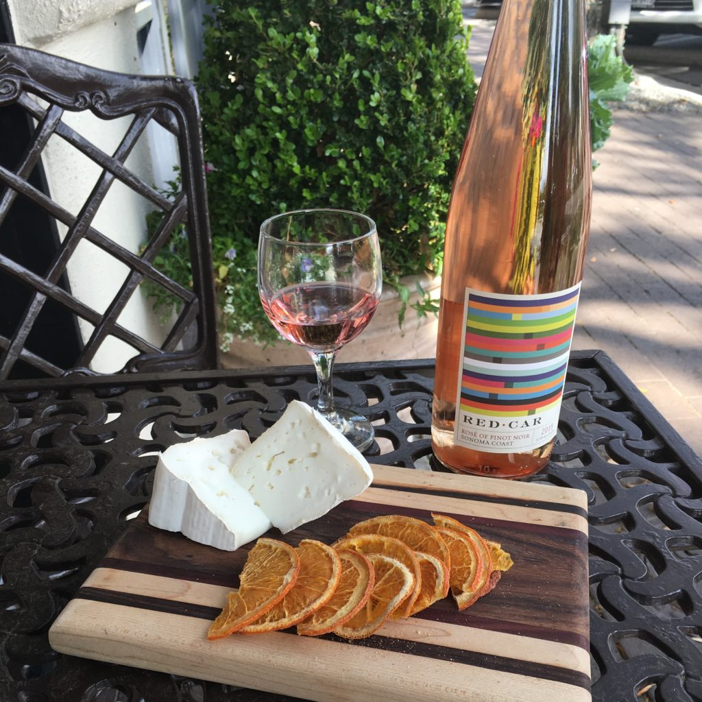 Enjoy a class of Red Car Rosé of Pinot Noir Syrah with your favorite cheeses and dried fruit on the patio at Molto Formaggio, or step inside and take a private class to learn about wine and cheese pairings.