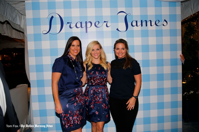 Oscar-winning actress Reese Witherspoon with Highland Park Village co-owners Heather Washburne (left) and Elisa Summers (right) Wednesday night's opening party for her Dallas Draper James store.Tom Fox/Staff Photographer
