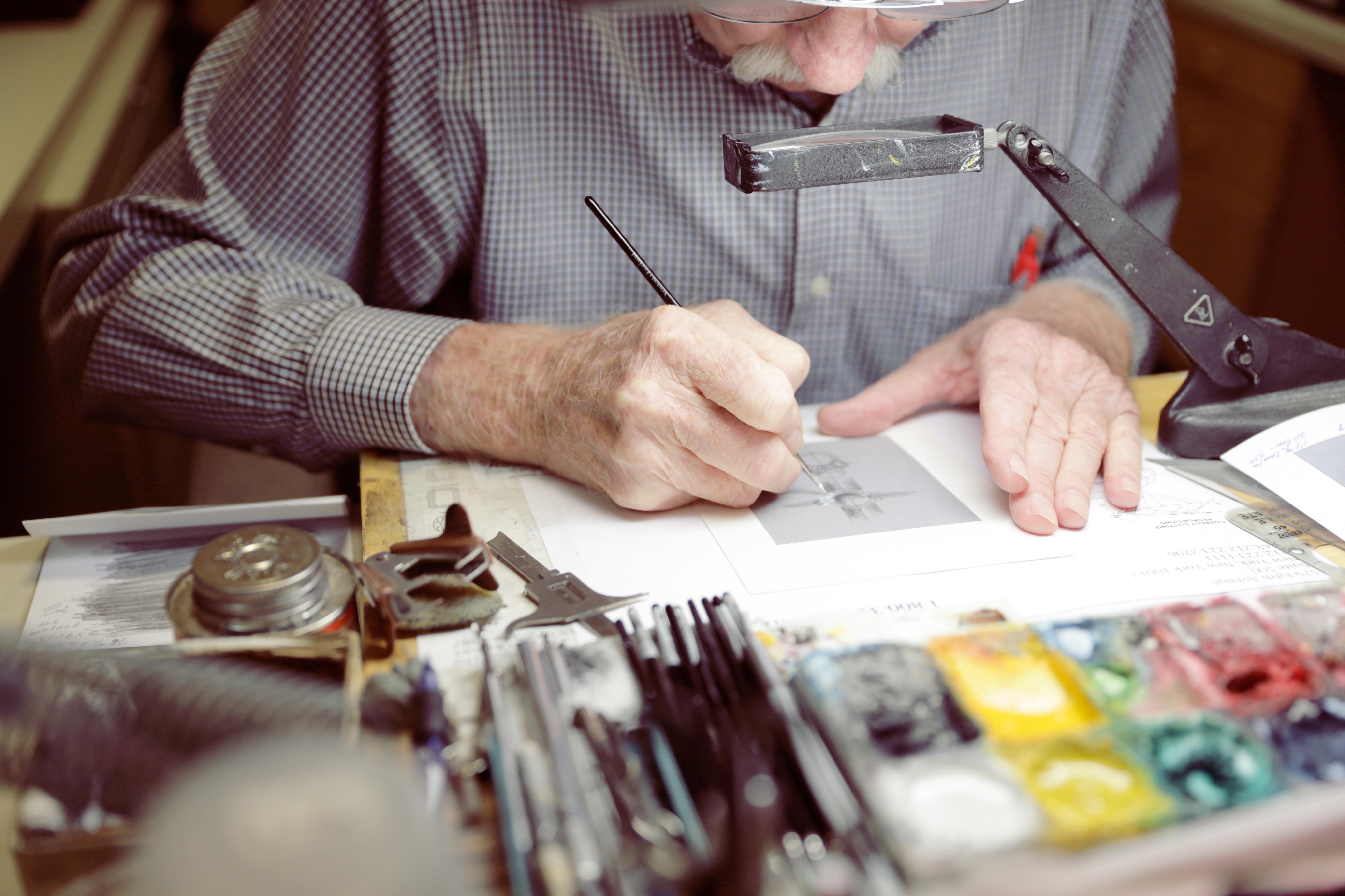 Designer Sam Ziegler sketching a custom design.